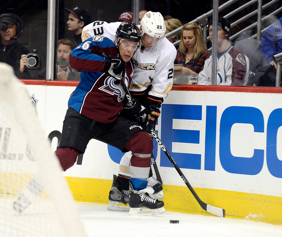 . DENVER, CO. - FEBRUARY 06: Paul Stastny (26) of the Colorado Avalanche pins Francois Beauchemin (23) of the Anaheim Ducks agians the boards during the first period February 6, 2013 at Pepsi Center. The Colorado Avalanche take on the Anaheim Ducks during NHL action. (Photo By John Leyba / The Denver Post)