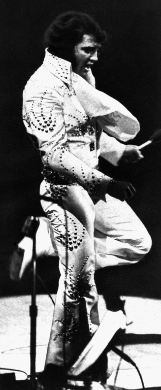 . NEW YORK, NY, November 13, 1977 The late rock \'n\' rol king Elvis Presley, left, does his thing during a 1972 concert in New York. (AP Photo)