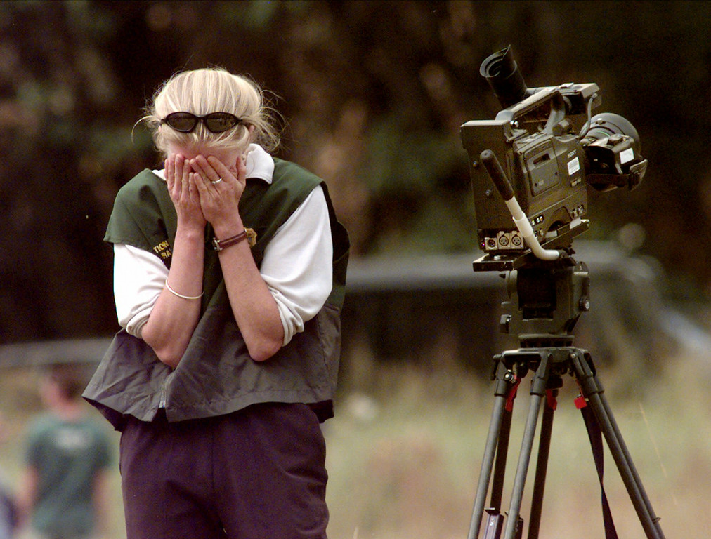 . Kristin Ramsey, a videographer for the National Park Service, holds her face after witnessing skydiver Jan Davis die after jumping from El Capitan in Yosemite, Calif., National Park, Friday, Oct. 22, 1999. Davis was one of five parachutists taking part in a protest of park rules banning such jumps. Davis, of Santa Barbara, Calif., plunged to her death after her chute failed to open. (AP Photo/Paul Sakuma)