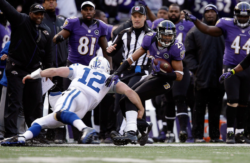 . Cary Williams #29 of the Baltimore Ravens returns an interception for positive yards against Andrew Luck #12 of the Indianapolis Colts during the AFC Wild Card Playoff Game at M&T Bank Stadium on January 6, 2013 in Baltimore, Maryland.  (Photo by Rob Carr/Getty Images)
