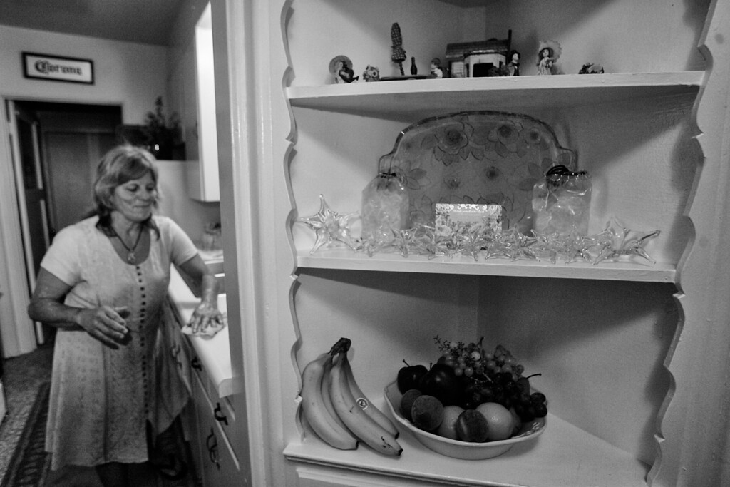 . Dorothy cleans her kitchen in her new home provided by Housing Works.