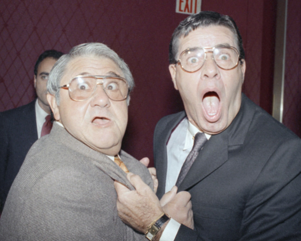. Jerry Lewis, right, and Buddy Hackett react at a Friars Club roast, Wednesday, Oct. 15, 1986, New York. Hackett was the roast master as the Friars speared, sheared, zinged and zapped Lewis at their annual celebrity roast luncheon. (AP Photo/Joel Landau)