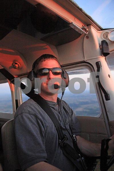 Young civilian pilot performing his pre-flight on a Cessna.
