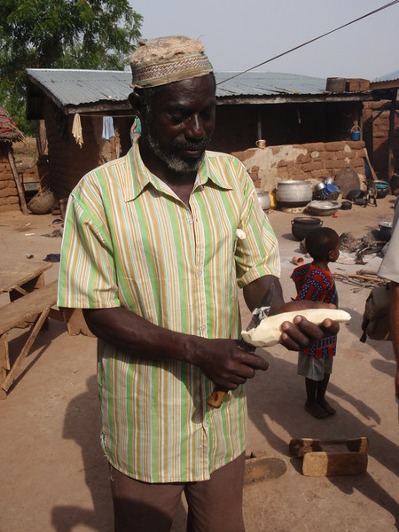 023_Between Tamale and Kumasi. Village Life. Peeling Casavas.jpg