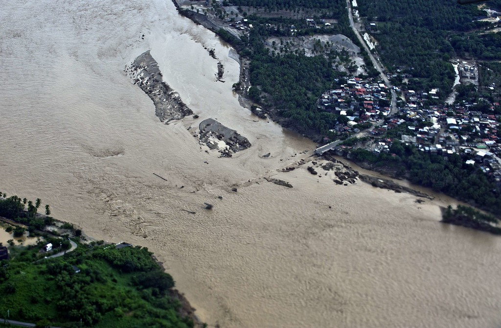 . Aerial view of a fallen bridge over the Papagayo River in Acapulco, state of Guerrero, Mexico, on September 17, 2013 as heavy rains hit the country. Mexican authorities scrambled Tuesday to launch an air lift to evacuate tens of thousands of tourists stranded amid floods in the resort of Acapulco following a pair of deadly storms. The official death toll rose to 47 after the tropical storms, Ingrid and Manuel, swarmed large swaths of the country during a three-day holiday weekend, sparking landslides and causing rivers to overflow in several states.  Ronaldo Schemidt/AFP/Getty Images