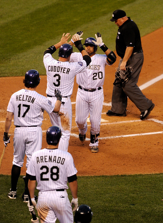 . DENVER, CO. - AUGUST 09: Wilin Rosario rounded the bases with a second inning home run that drove in teammate Michael Cuddyer. The Colorado Rockies hosted the Pittsburgh Pirates Friday night, August 9, 2013. Photo By Karl Gehring/The Denver Post