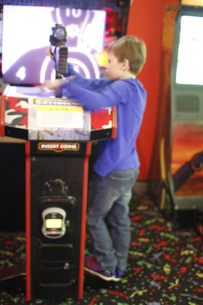 he was too short to stand behind this game, so he stood on the side - he still did great!