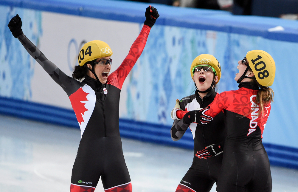 . From left, Canada\'s Marie-Eve Drolet, Valerie Maltais and Marianne St-Gelais celebrate winning the silver medal in the women\'s 3,000 meter relay final at the Sochi Winter Olympics Tuesday, Feb. 18, 2014 in Sochi. (AP Photo/The Canadian Press, Paul Chiasson)
