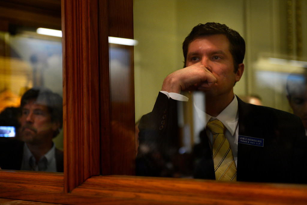 . DENVER, CO. - FEBRUARY 15: John O. Karakoulakis of Holland and Hart LLP watches from outside during argument on HB 1224 prohibiting large capacity ammunition magazines in the Colorado House at the Denver State Capitol February 15, 2013. Denver, Colorado. (Photo By Joe Amon/The Denver Post)
