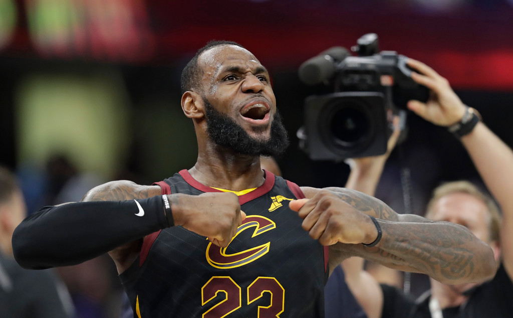 . Cleveland Cavaliers\' LeBron James celebrates after scoring the game-winning shot in the second half of Game 5 of an NBA basketball first-round playoff series against the Indiana Pacers, Wednesday, April 25, 2018, in Cleveland. The Cavaliers won 98-95. (AP Photo/Tony Dejak)