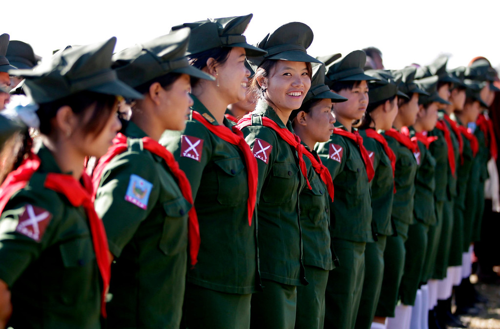 . Nurses in uniforms of the Ta-ang National Liberation Army (TNLA) attend the 51st anniversary of Ta-ang Army Revolution Day in Homain village, Nansam Township, Northern Shan State, Myanmar, 12 January 2014.   EPA/NYEIN CHAN NAING