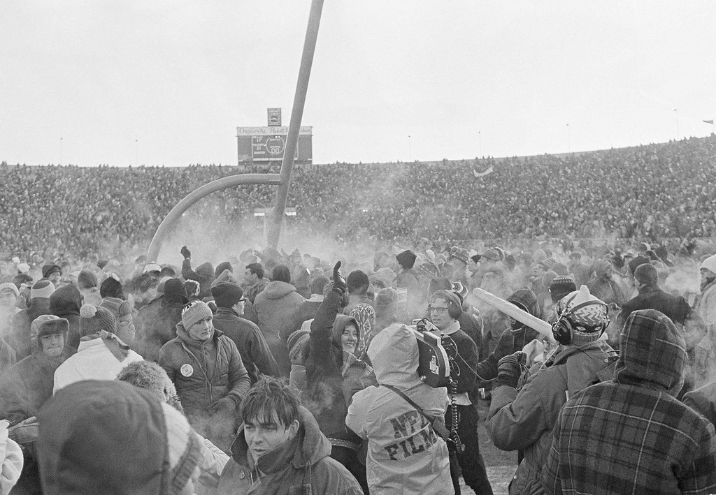 . Green Bay Packers fans pack the football field to celebrate the Packers\' 21-17 win over the Dallas Cowboys to capture their third consecutive NFL championship in Green Bay, Wis., Dec. 31, 1967. (AP Photo)
