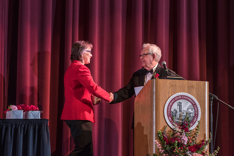 President Gayle Hutchinson (left) recognizes Distinguished Alumni recipient Gary Watters (CIVL, '57) (right) during an evening dinner on Friday, March 9, 2018 in Chico, Calif.  (Jason Halley/University Photographer/CSU Chico)