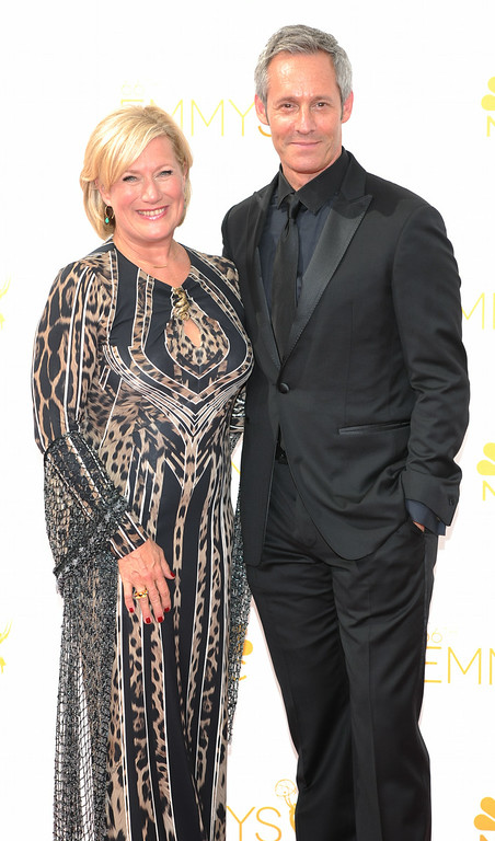 . Jayne Atkinson, left, and Michael Gill on the red carpet at the 66th Primetime Emmy Awards show at the Nokia Theatre in Los Angeles, California on Monday August 25, 2014. (Photo by John McCoy / Los Angeles Daily News)