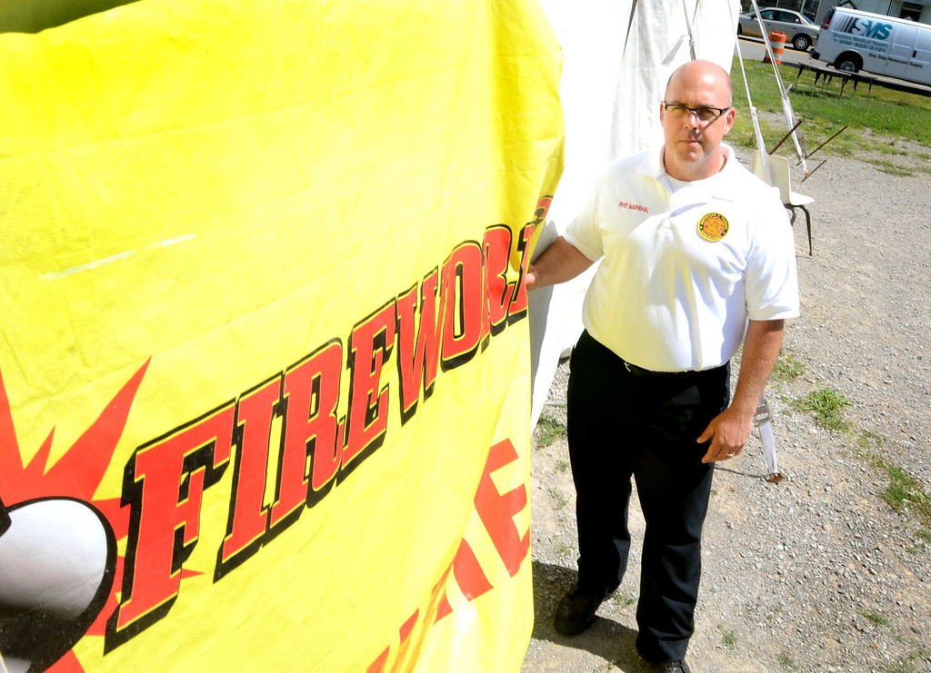 . Waterford Township Fire Marshall Matt Covey at a fireworks stand in Waterford.    Wednesday, July 24, 2013.  The Oakland Press/TIM THOMPSON