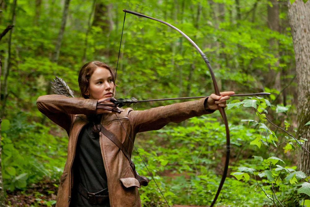 ". Jennifer Lawrence brings to screen ""The Hunger Games\"" hero Katniss Everdeen."