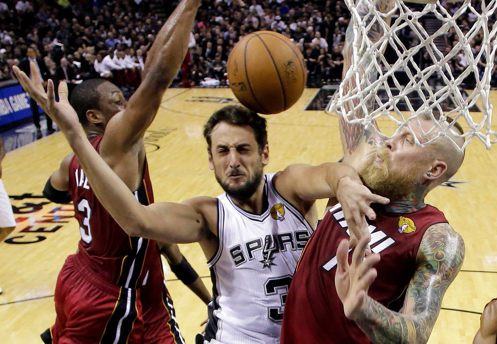 . San Antonio Spurs guard Marco Belinelli (3) is caught between Miami Heat guard Dwyane Wade (3) and forward Chris Andersen (11) during the first half in Game 1 of the NBA basketball finals on Thursday, June 5, 2014, in San Antonio. (AP Photo/Eric Gay, Pool)
