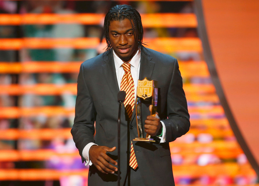 . Washington Redskins quarterback Robert Griffin III accepts the the award for the NFL Offensive Rookie of the year during the NFL Honors award show in New Orleans, Louisiana February 2, 2013.   REUTERS/Jeff Haynes