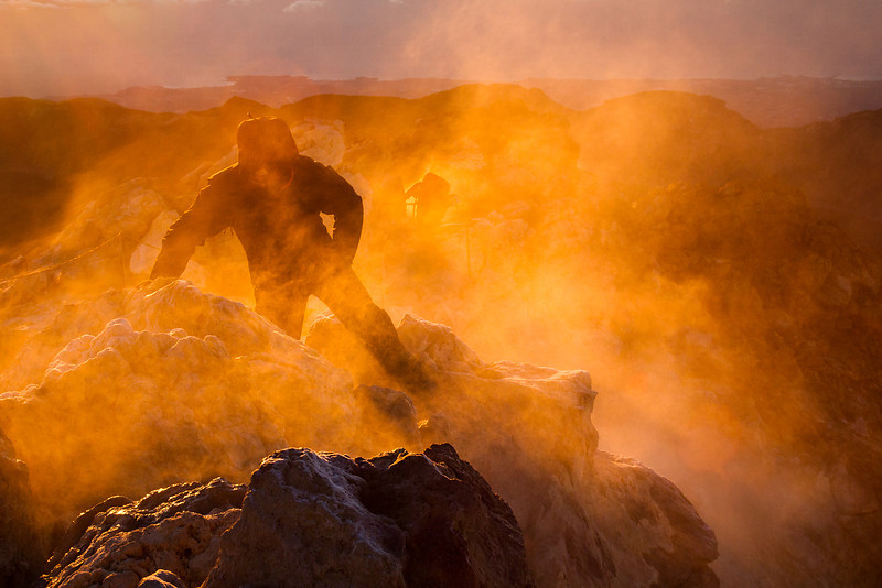 The volcanic fumes from El Teide burn orange in the rising sun, as Najmus scrambles over the slippery rocks to the top of Spain, 3718 m.