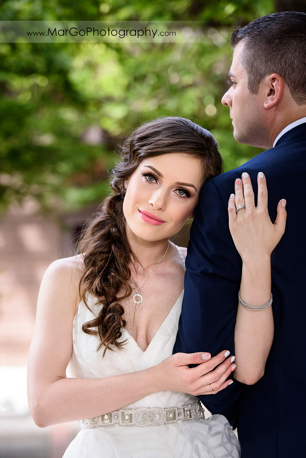 portrait of bride holding hands on groom's arm at Saratoga Foothill Club