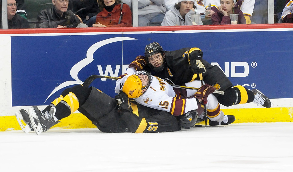 . Minnesota\'s A.J. Michaelsson (15) is stuck between Colorado College\'s Eamonn McDermott, (7) and Andrew Hamburg (15)  after a collision during the first period of the WCHA Final Five at the Xcel Energy Center Arena on March 22, 2013. (Pioneer Press: Sherri LaRose-Chiglo)