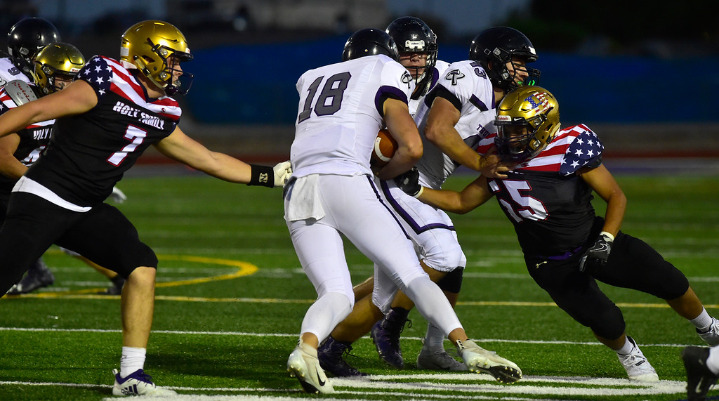 . BROOMFIELD CO - SEPTEMBER 14 2018 Holy Family High School\'s Kyle Helbig anDiscovery Canyon High\'s during their game in Broomfield on Friday September 14, 2018. More photos bocopreps.com  (Photo by Paul Aiken/Staff Photographer)