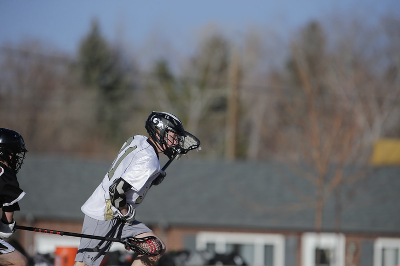 JPM0011-JPM0011-Jonathan first HS lacrosse game March 9th.jpg