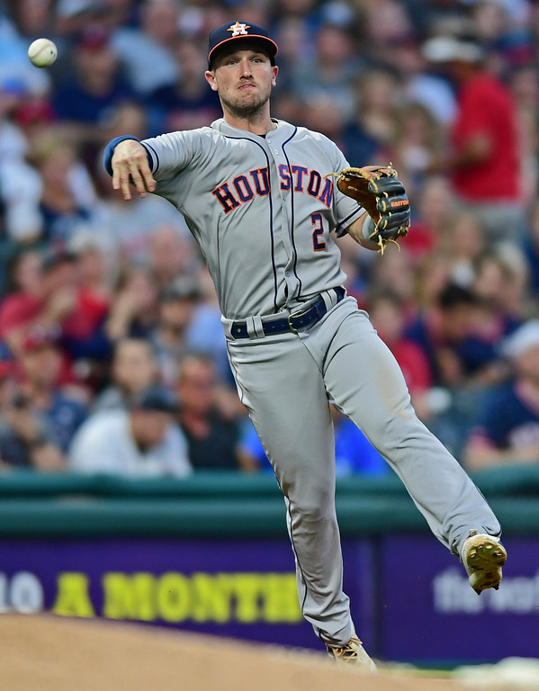 . Hoston Astros\' Alex Bergman throws to first base for the out on Cleveland Indians\' Francisco Lindor during the fifth inning of a baseball game Friday, May 25, 2018, in Cleveland. (AP Photo/David Dermer)