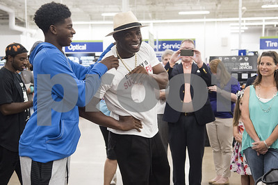 commentary-cowboys-hall-of-famer-deion-sanders-gives-canton-tornado-victims-a-successful-day