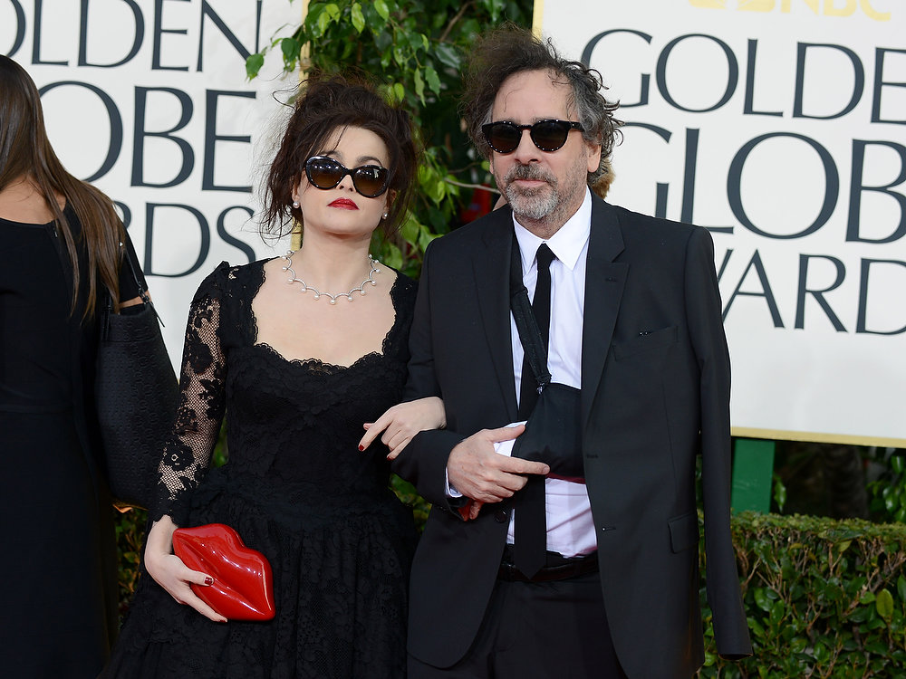Description of . Actress Helena Bonham Carter, left, nd and director Tim Burton arrive at the 70th Annual Golden Globe Awards at the Beverly Hilton Hotel on Sunday Jan. 13, 2013, in Beverly Hills, Calif. (Photo by Jordan Strauss/Invision/AP)