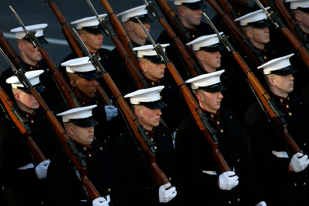 Description of . U.S. Marines march in the inaugural parade in Washington, January 21, 2013.  REUTERS/Jonathan Ernst