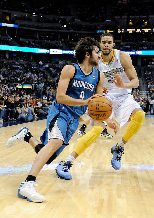 . Minnesota Timberwolves guard Ricky Rubio, left, of Spain, drives past Denver Nuggets center JaVale McGee in the first quarter of an NBA basketball game on Saturday, March 9, 2013, in Denver.  (AP Photo/Chris Schneider)