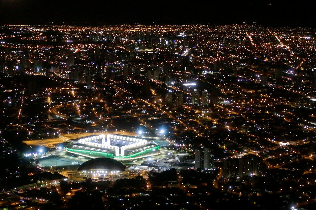 . A night aerial view of the illuminated Arena Pantanal where Japan and Colombia met up for their group C World Cup soccer match, in Cuiaba, Brazil, Tuesday, June 24, 2014. Colombia defeated Japan 4-1, securing a top spot in Group C and eliminating the Asian champions. It was Colombia\'s third straight win and set up a second-round match against Uruguay. (AP Photo/Felipe Dana)