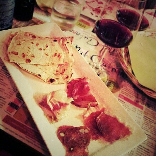 I_may_have_left_Spain_but_there_s_plenty_of_pig_in_Rimini._Delicious_pork_with_piadinis_and_local_red_wine._I_forgot_how_much_I_loved_Italy..jpg
