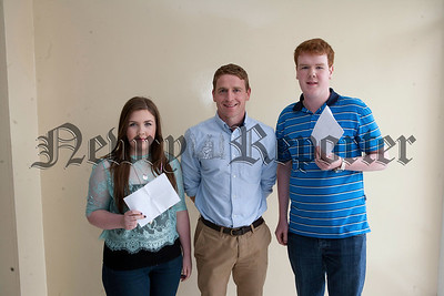Head of Year Mr McArdle is pictured with pupils Niamh Cluett (7A* and 3 A's) and Joseph Mee (9A* and 3A's). R1435007