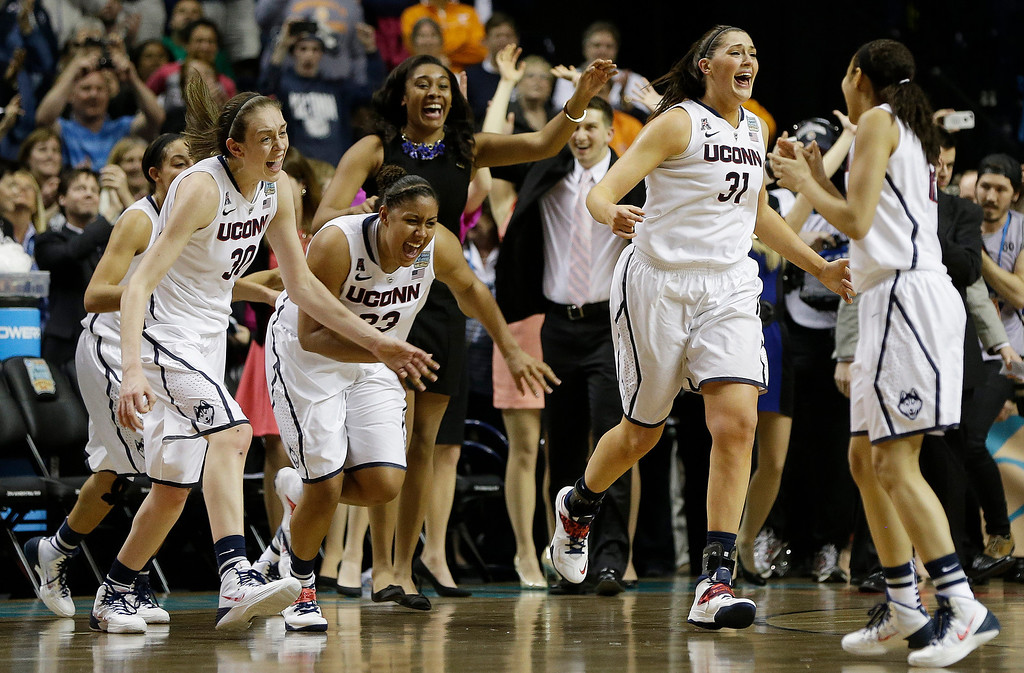 . Connecticut players leave the bench after the second half of the championship game against Notre Dame in the Final Four of the NCAA women\'s college basketball tournament, Tuesday, April 8, 2014, in Nashville, Tenn. Connecticut won 79 -58. (AP Photo/Mark Humphrey)
