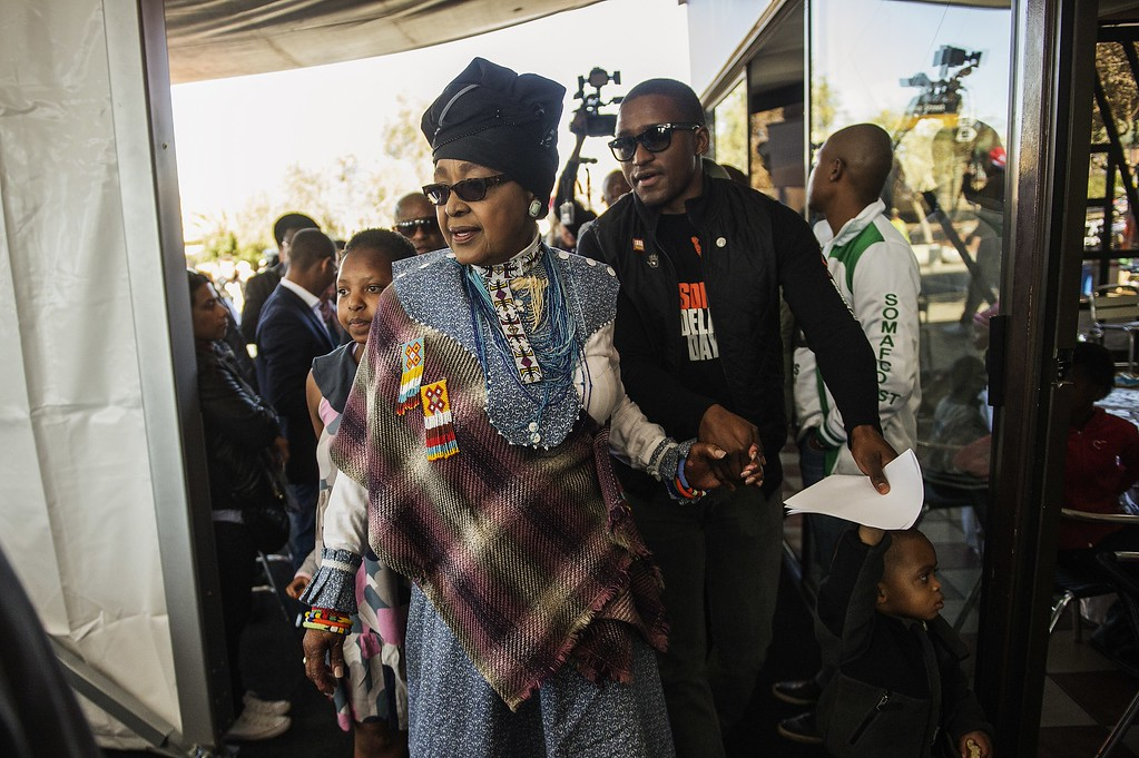 . Winnie Madikizela Mandela(C), ex-wife of the late South African President, Nobel Peace prize laureate and Global Icon Nelson Mandela, arrives at the Mandela\' family restaurant by his former house now turned museum, to attend activities marking International Mandela Day on July 18, 2014 in Johannesburg. Mandela Day is a global call to action that celebrates the idea that each individual has the power to transform the world, the ability to make an impact. Nelson Mandela International Day (or Mandela Day) is an annual international day in honour of Nelson Mandela, celebrated each 18 July (on Mandela\'s birthday). The day was officially declared by the United Nations in November 2009, with the first UN Mandela Day held on 18 July 2010.        (GIANLUIGI GUERCIA/AFP/Getty Images)