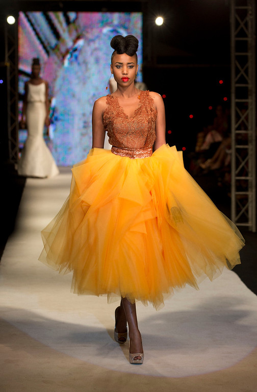 . A model wears a creation by Elie Kuame, of Lebanon and Ivory Coast, at Hotel des Almadies, in Dakar, Senegal, Saturday, June 22, 2013. After a Friday show held in a dusty marketplace in the working class suburb of Guediawaye, the runway finale of Dakar Fashion Week was held at a luxury hotel and showcased the work of 14 designers from West Africa, Europe, South America, and the Caribbean. (AP Photo/Rebecca Blackwell)