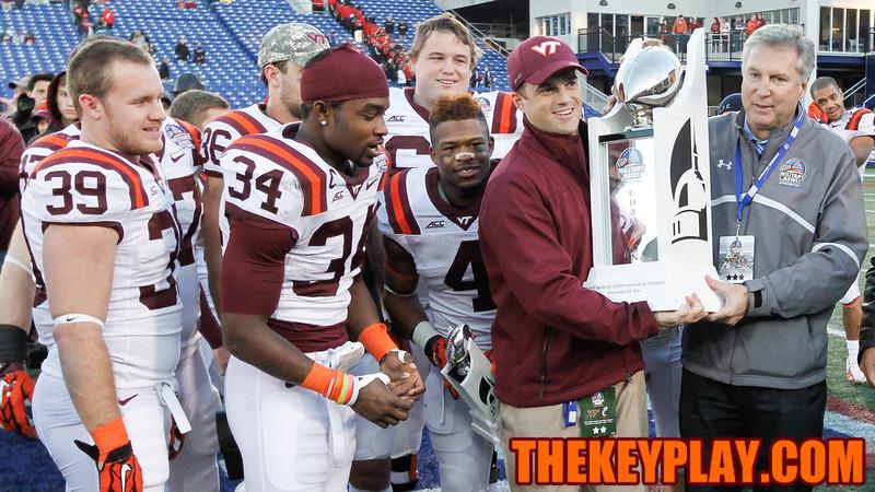 Shane Beamer recieves the Military Bowl trophy. (Mark Umansky/TheKeyPlay.com)