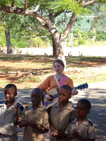 JAFSP staff member Stacy, on guitar, Pedro Plains Primary. Photo by Eric Wills.