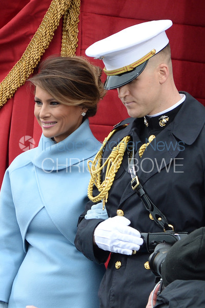 The new First Lady, Melania Trump is escorted to her seat prior to the swearing in ceremony at her husband's Presidential Inauguration.
