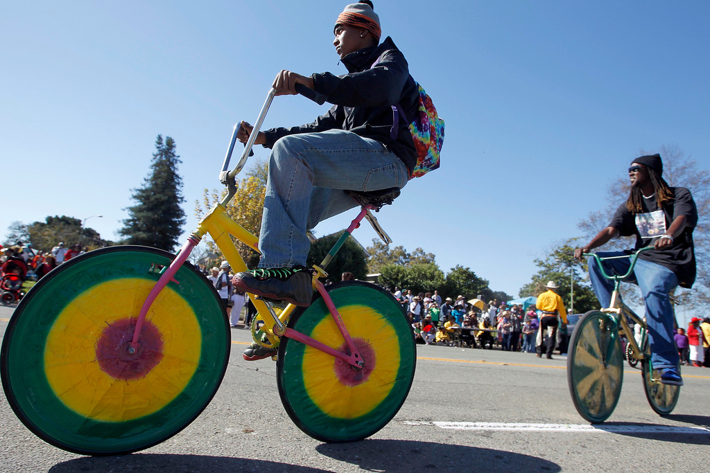 . Chuck Davis, 15, and members of the Original Scraper Bikes ride past the reviewing stand on 18th Street during the 39th annual Oakland Black Cowboy Parade and Heritage Festival in Oakland, Calif., on Saturday, Oct. 5, 2013. The event also featured food, entertainment and pony rides for kids. The Oakland Black Cowboy Associaiton began in 1975 and educates the public about the role that black cowboys played in history and building of the west. (Jane Tyska//Bay Area News Group)