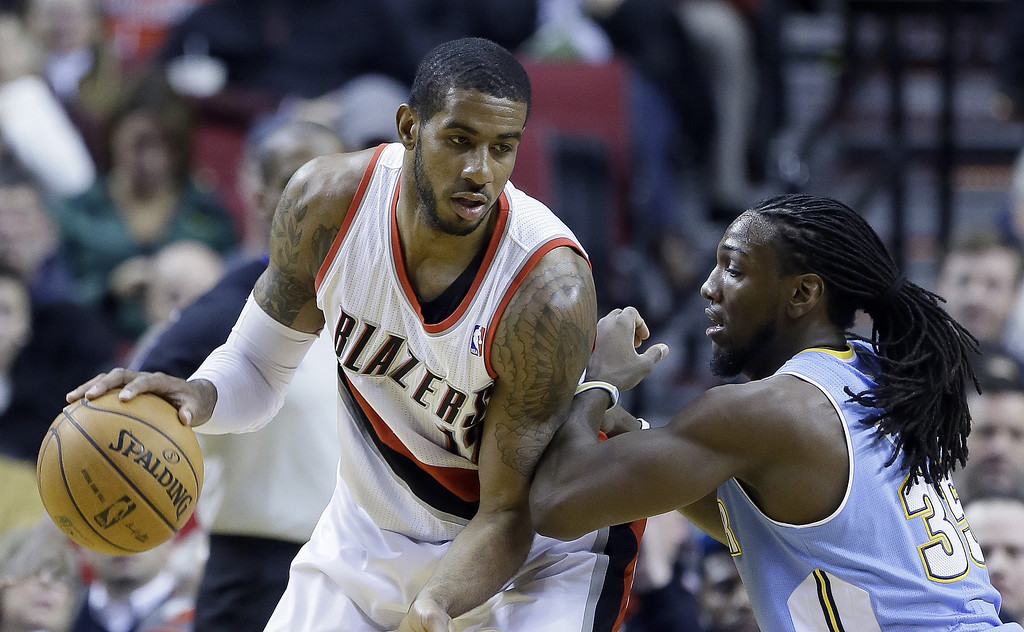 . Portland Trail Blazers forward LaMarcus Aldridge, left, works the ball against Denver Nuggets forward Kenneth Faried during the first half of an NBA basketball game in Portland, Ore., Thursday, Jan. 23, 2014. (AP Photo/Don Ryan)
