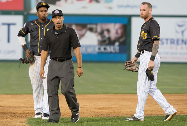 09/03/19 Wesley Bunnell | StaffrrThe New Britain Bees defeated the Somerset Patriots 7-6 in the bottom of the 8th on what was scheduled to be a 7 inning first game of a doubleheader. Rando Moreno (4) and Ryan Jackson (8) look over at third base umpire Eric Carmona after Carmona ejected Jackson from the game for arguing a close play at second base.