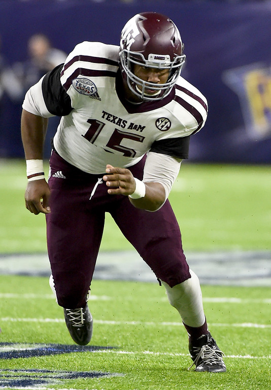 . Texas A&M defensive lineman Myles Garrett (15) is shown during the second half of the Texas Bowl NCAA college football game, Wednesday, Dec. 28, 2016, in Houston. Kansas State won the game, 33-28. (AP Photo/Eric Christian Smith)