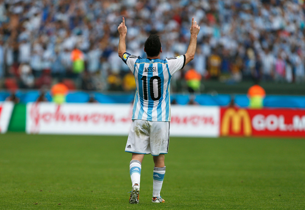 . Argentina\'s Lionel Messi celebrates after scoring his side\'s second goal during the group F World Cup soccer match against Nigeria at the Estadio Beira-Rio in Porto Alegre, Brazil, Wednesday, June 25, 2014. (AP Photo/Jon Super)