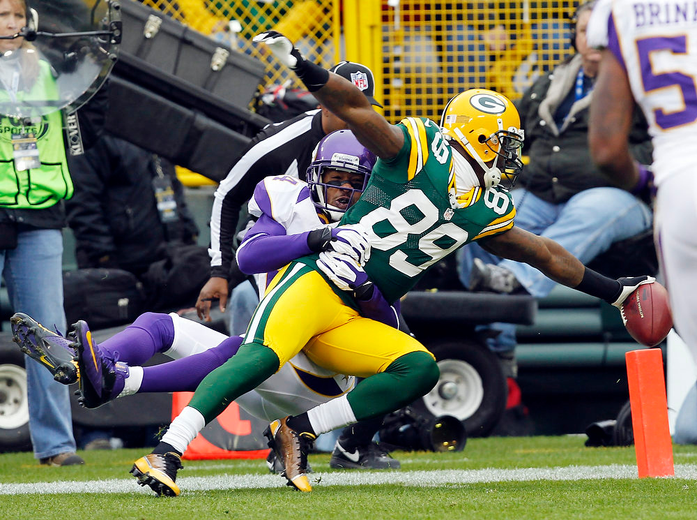 . Minnesota Vikings cornerback A.J. Jefferson can\'t stop Green Bay Packers wide receiver James Jones (89) from crossing the goal line after catching a touchdown pass  during the first half of an NFL football game Sunday, Dec. 2, 2012, in Green Bay, Wis. (AP Photo/Mike Roemer)