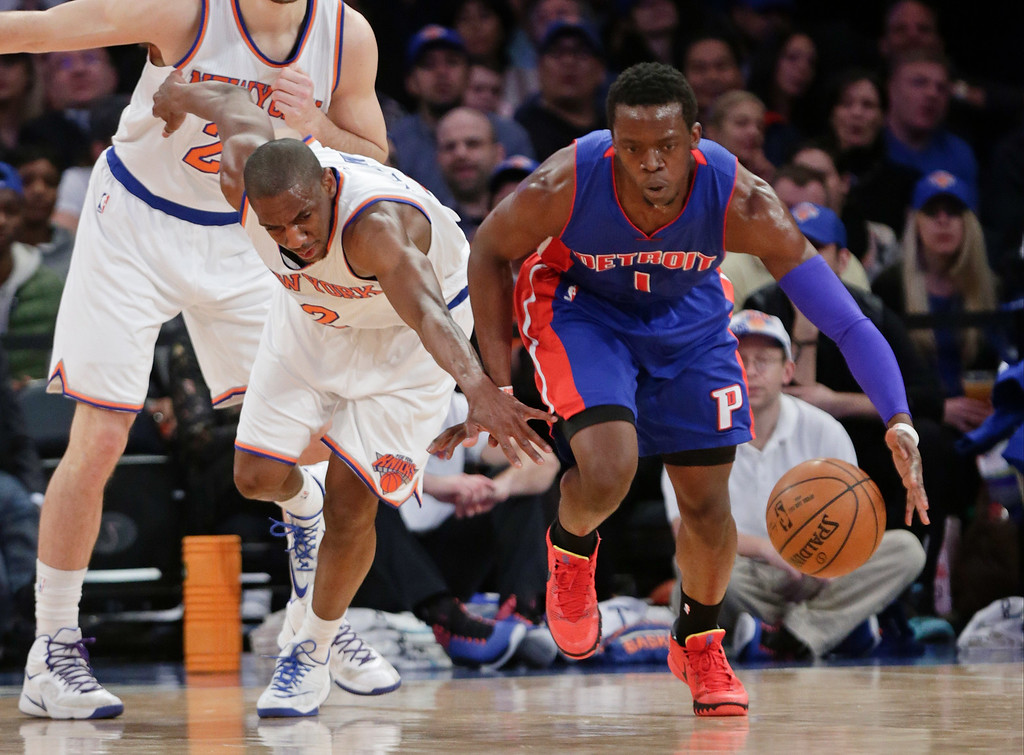 . Detroit Pistons\' Reggie Jackson (1) steals the ball from New York Knicks\' Langston Galloway (2) during the first half of an NBA basketball game Wednesday, April 15, 2015, in New York. (AP Photo/Frank Franklin II)