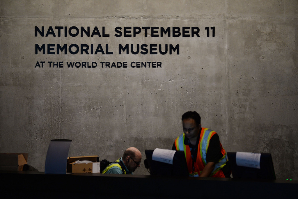 . Workers prepare for the opening of the National September 11 Memorial Museum at the World Trade Center site May 14, 2014 in New York. AFP PHOTO/Stan HONDA/AFP/Getty Images