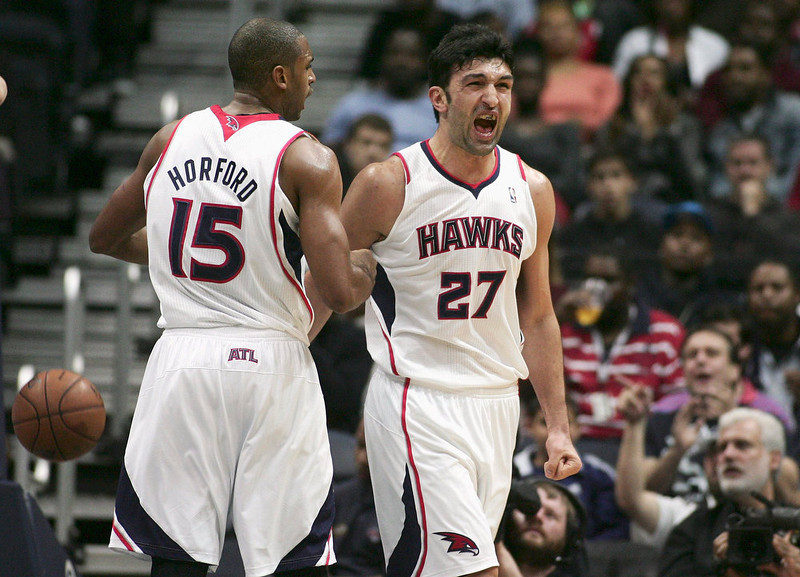 . Atlanta Hawks center Zaza Pachulia (27) reacts after he was fouled by the Denver Nuggets as teammate Al Horford (15) looks on in the first half of their NBA basketball game in Atlanta, Georgia  December 5, 2012. REUTERS/Tami Chappell